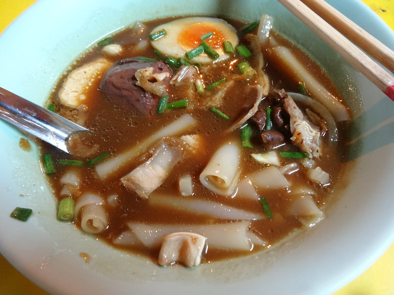 Pork and flat noodle soup
